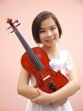 Girl and Violin Royalty Free Stock Image