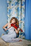 Girl and violin Stock Images