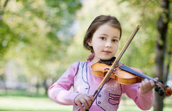 Girl with violin outdoor Royalty Free Stock Photo