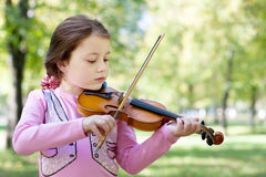 Girl with violin outdoor Stock Photography