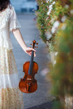 Girl with violin outdoor Stock Image