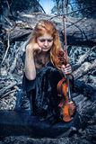 Girl with a violin outdoor Stock Photography