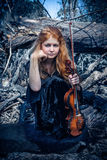 Girl with a violin outdoor Royalty Free Stock Images