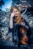 Girl with a violin outdoor Stock Photo
