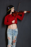 Girl with violin. Pretty skinny girl playing on violin in the room Stock Photography