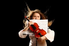 Girl violinist and pult Stock Photos