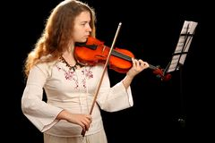 Girl violinist and pult Stock Images