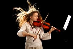 Girl violinist and pult Stock Image