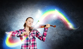 Girl violinist Stock Images