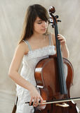 Girl with violoncello. Portrait of young girl with violoncello royalty free stock photography