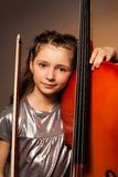 Girl with violoncello and string on gel background Royalty Free Stock Image