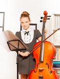 Girl with violoncello, string and musical notes Stock Photography