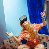 Girl in virtual reality glasses. Cheerful girl in virtual reality glasses smiling. VR glasses. Virtual reality. Third dimension royalty free stock photo