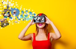 Girl with virtual reality glasses dreaming about vacation. Young redhead girl with virtual reality glasses dreaming about vacation on yellow background Royalty Free Stock Image
