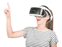 A girl in virtual reality glasses enjoys his trip in an adventurous world, isolated on a white background. A concept of global web Royalty Free Stock Images