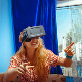 Girl in virtual reality glasses. Happy girl in virtual reality glasses smiling. VR glasses. Virtual reality. Third dimension stock photo