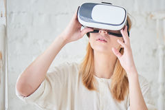The girl in the virtual reality helmet Royalty Free Stock Photos