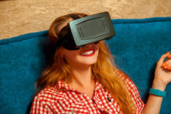 Girl in virtual reality smiling. Portrait of happy beauty girl in virtual reality helmet smiling. VR glasses. Virtual reality. Third dimension royalty free stock images