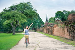 Girl visiting Ayutthaya in Thailand on bicycle Stock Photography