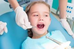 Girl visiting dentists, visit the dentist Stock Image