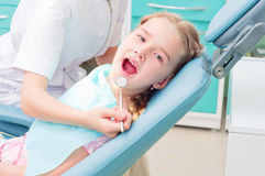 Girl visiting dentists, visit the dentist Stock Photography