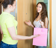 Girl visiting her girlfriend Royalty Free Stock Photography