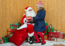 Girl visiting Santas grotto Royalty Free Stock Photo