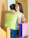 Girl visiting sister with birthday present Stock Photos