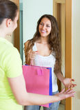 Girl visiting sister with birthday present Royalty Free Stock Photography
