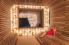 The girl visits the saline room for inhalation of the lungs and. Respiratory tract. Room from the Himalayan salt and dosing salt from the dead sea Stock Photo