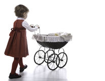 Girl vith vintage pushchair Royalty Free Stock Photo