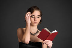 Girl with a volume of poetry Stock Photo