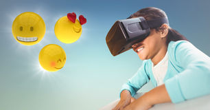 Girl in VR with emojis and flares against blue green background. Digital composite of Girl in VR with emojis and flares against blue green background Stock Photos