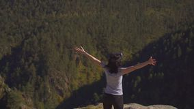 Girl in vr glasses lifted her hands up in the mountains. Of delight stock photography