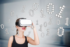 Girl in vr glasses with zeros and ones Stock Photo