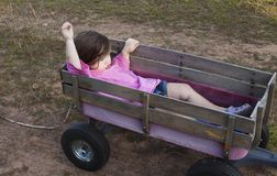 Girl in a wagon Royalty Free Stock Images