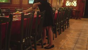 Girl waiter delivers food in a restaurant to the beginning of the celebration, 4K stock video footage