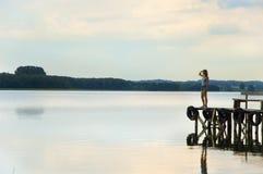 Girl waiting. On the lake bridge Stock Image