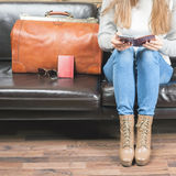 Girl waiting airplane in VIP lounge rom, airport Stock Photo