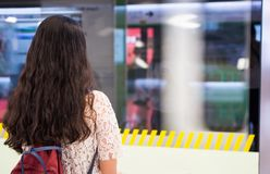 Girl waiting for a train at the subway station Stock Photography