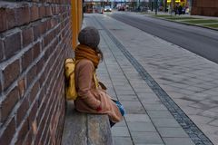 Girl waiting for a bus royalty free stock photography