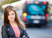 Girl waiting at bus stop Royalty Free Stock Photos