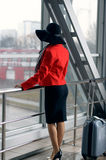 Girl waiting for departure Stock Images