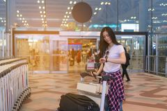 The girl is waiting for a friend. Traveling to the airport. She stood up to watch the time. Copy space stock photos