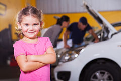 Girl waiting garage Royalty Free Stock Photo