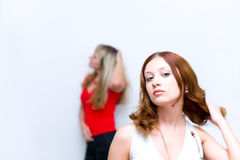 Girl waiting when girlfriend correcting hairstyle Royalty Free Stock Photography