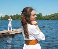 Girl waiting for her boyfriend. The guy holding the boat with re Stock Image