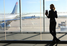Girl Waiting her Flight in Airport Terminal stock images