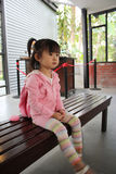 Girl waiting for her parents. Cutie girl is waiting for her parents for visit the tea plantation at Cameron Highland Royalty Free Stock Images