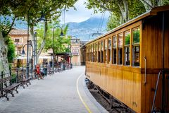 The girl is waiting for historic tram. Historic tram in Soller. The girl is waiting for historic tram. Historic tram in Soller, Spain stock image